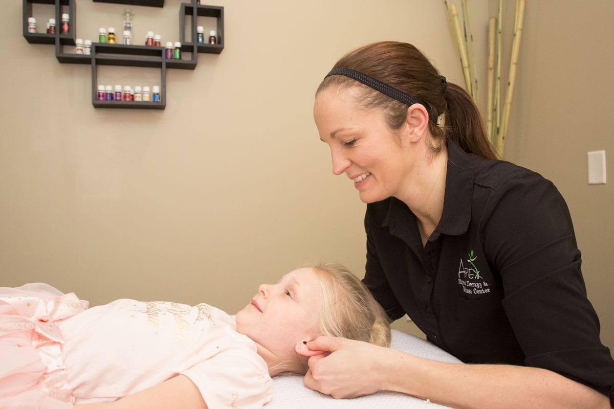 Katie helping a child with Cranio Sacral Therapy