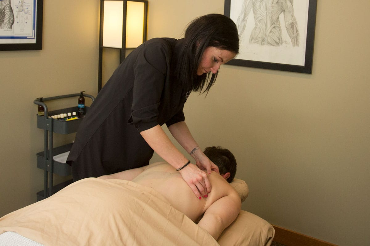 Our Massage therapist Sara Dutt performing massage therapy on a patient